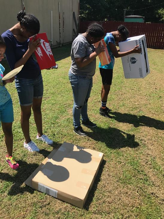 "<div class=""meta image-caption""><div class=""origin-logo origin-image none""><span>none</span></div><span class=""caption-text"">Danielle, Arianna, Jazlyn and Jayla from Henderson, NC trying to view the solar eclipse with their DIY Solar Viewers (Credit: Alicia Long)</span></div>"