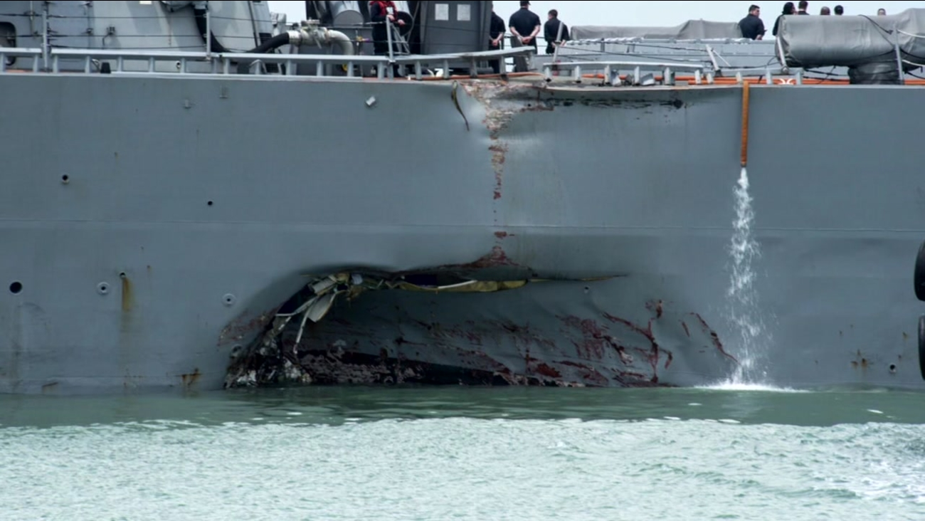 Navy official confirms 'some remains' found after USS McCain collision