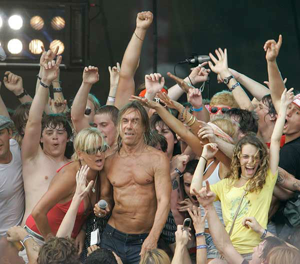 """<div class=""""meta image-caption""""><div class=""""origin-logo origin-image none""""><span>none</span></div><span class=""""caption-text"""">Iggy Pop invites fans on stage during his performance at Lollapalooza 2007 (AP Photo/Brian Kersey)</span></div>"""