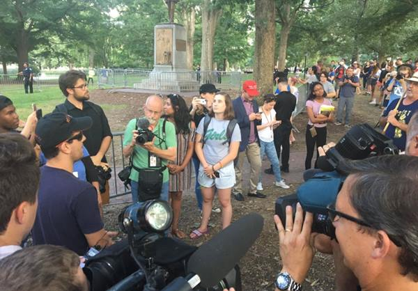 "<div class=""meta image-caption""><div class=""origin-logo origin-image wtvd""><span>WTVD</span></div><span class=""caption-text"">Protestors gather on UNC's campus to protest the Silent Sam statue (Credit: Angelica Alvarez/Twitter)</span></div>"