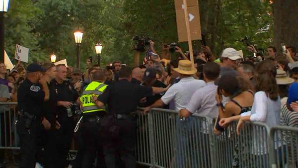"<div class=""meta image-caption""><div class=""origin-logo origin-image wtvd""><span>WTVD</span></div><span class=""caption-text"">Protesters gather at the Silent Sam statue on Tuesday.</span></div>"
