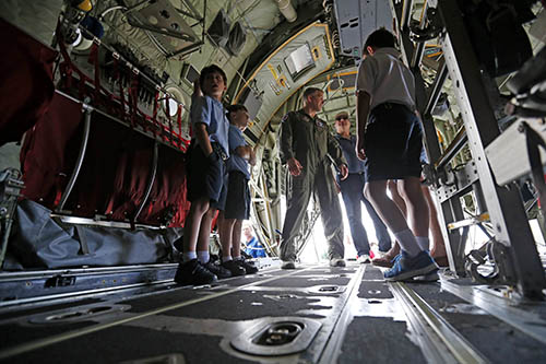 <div class='meta'><div class='origin-logo' data-origin='AP'></div><span class='caption-text' data-credit='AP Photo/Gerald Herbert'>Children from St. Angela Merici grammar school tour a WC-130J hurricane hunter aircraft, which is open for public tours at New Orleans Lakefront Airport in New Orleans.</span></div>