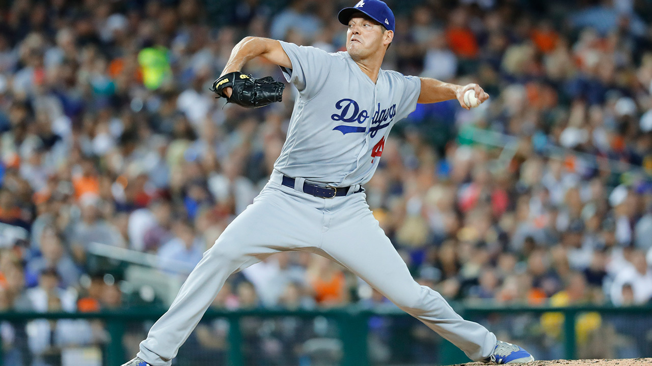 Los Angeles Dodgers pitcher Rich Hill throws against the Detroit Tigers in the fifth inning of a baseball game in Detroit, Friday, Aug. 18, 2017.