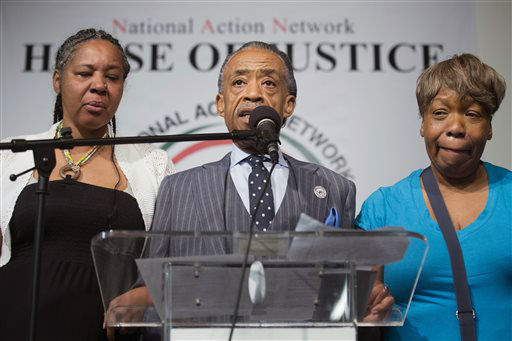 "<div class=""meta image-caption""><div class=""origin-logo origin-image ""><span></span></div><span class=""caption-text"">Rev. Al Sharpton speaks alongside Esaw Garner, wife of Eric Garner, left, and Gwen Carr, Eric Garner's mother, during a rally at the National Action Network headquarters. (AP Photo/ John Minchillo)</span></div>"