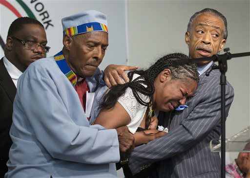 "<div class=""meta image-caption""><div class=""origin-logo origin-image ""><span></span></div><span class=""caption-text"">Esaw Garner, center, wife of Eric Garner, breaks down in the arms of Rev. Herbert Daughtry and Rev. Al Sharpton, right, during a rally at the National Action Network. (AP Photo/ John Minchillo)</span></div>"