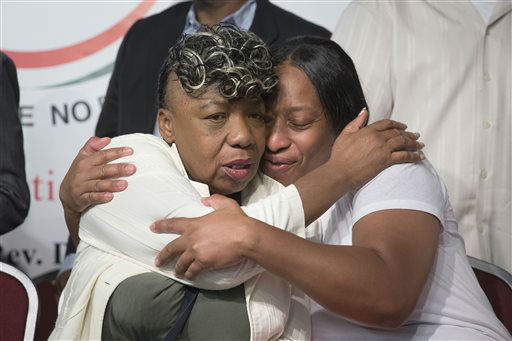 "<div class=""meta image-caption""><div class=""origin-logo origin-image ""><span></span></div><span class=""caption-text"">Gwen Carr, mother of Eric Garner, left, and his sister Ellisha Garner, hug during a rally at the National Action Network headquarters. (AP Photo/ John Minchillo)</span></div>"