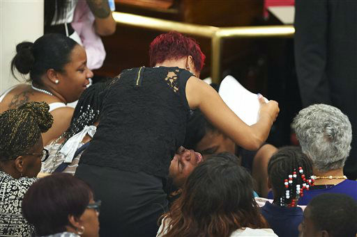"<div class=""meta image-caption""><div class=""origin-logo origin-image ""><span></span></div><span class=""caption-text"">Esaw Garner, center, cries during a funeral for her husband, Eric Garner, at Bethel Baptist Church. (AP Photo/ James Keivom)</span></div>"