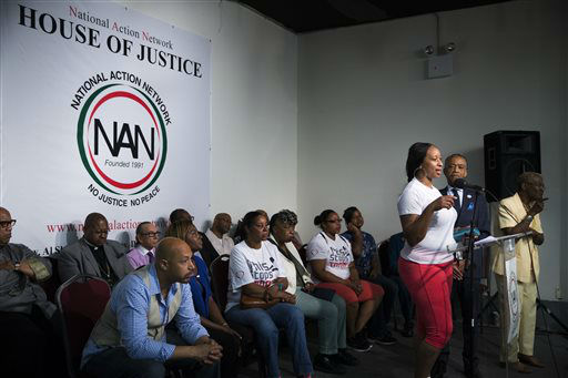 "<div class=""meta image-caption""><div class=""origin-logo origin-image ""><span></span></div><span class=""caption-text"">Ellisha Flagg, sister of Eric Garner, speaks alongside the Rev. Al Sharpton, second from right, during a rally at the National Action Network headquarters. (AP Photo/ John Minchillo)</span></div>"