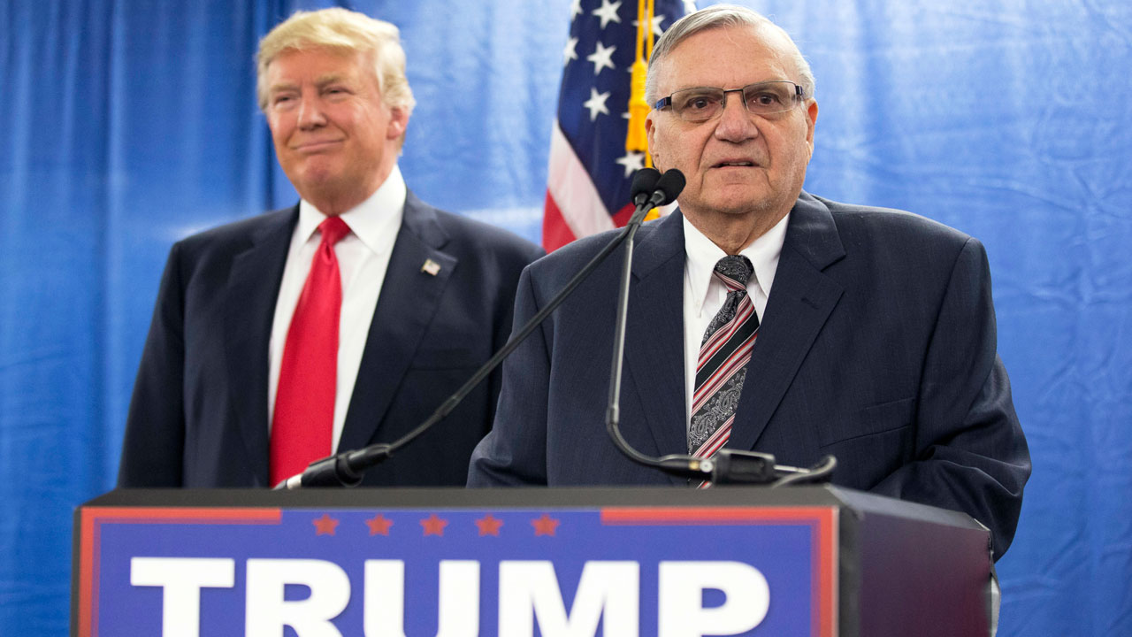In this Jan. 26, 2016, file photo, then-Republican presidential candidate Donald Trump is joined by Joe Arpaio, the then sheriff of metro Phoenix, during a news conference.