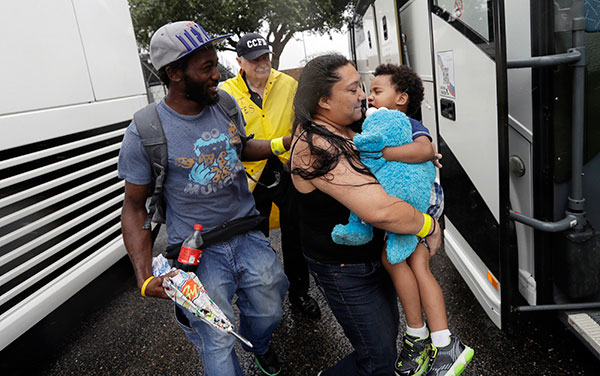 "<div class=""meta image-caption""><div class=""origin-logo origin-image none""><span>none</span></div><span class=""caption-text"">A family is helped to a bus as they are evacuated as the outer bands of Hurricane Harvey begin to make landfall, Friday, Aug. 25, 2017, in Corpus Christi, Texas. (Eric Gay/AP Photo)</span></div>"