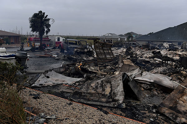 "<div class=""meta image-caption""><div class=""origin-logo origin-image none""><span>none</span></div><span class=""caption-text"">A burnt out house and cars that caught fire are seen after Hurricane Harvey hit Corpus Christi, Texas on August 26, 2017. (MARK RALSTON/AFP/Getty Images)</span></div>"