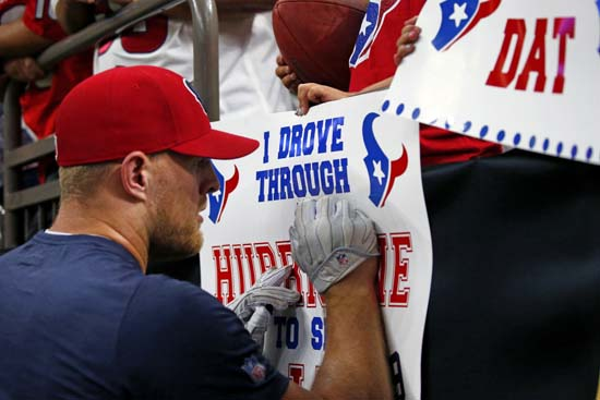 <div class='meta'><div class='origin-logo' data-origin='AP'></div><span class='caption-text' data-credit='AP'>Houston Texans defensive end J.J. Watt signs autographs for fans holding sings referencing Hurricane Harvey. (AP Photo/Butch Dill)</span></div>