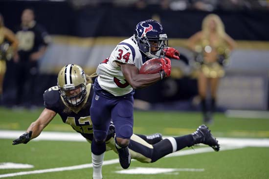 <div class='meta'><div class='origin-logo' data-origin='AP'></div><span class='caption-text' data-credit='AP'>Houston Texans running back Tyler Ervin (34) rushes past New Orleans Saints linebacker Bryan Braman(42) in the first half. (AP Photo/Bill Feig)</span></div>