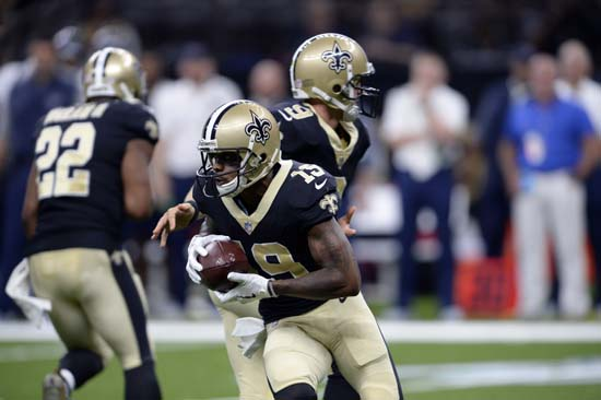 <div class='meta'><div class='origin-logo' data-origin='AP'></div><span class='caption-text' data-credit='AP'>New Orleans Saints quarterback Drew Brees (9) hands off to wide receiver Ted Ginn (19) in the first half. (AP Photo/Bill Feig)</span></div>