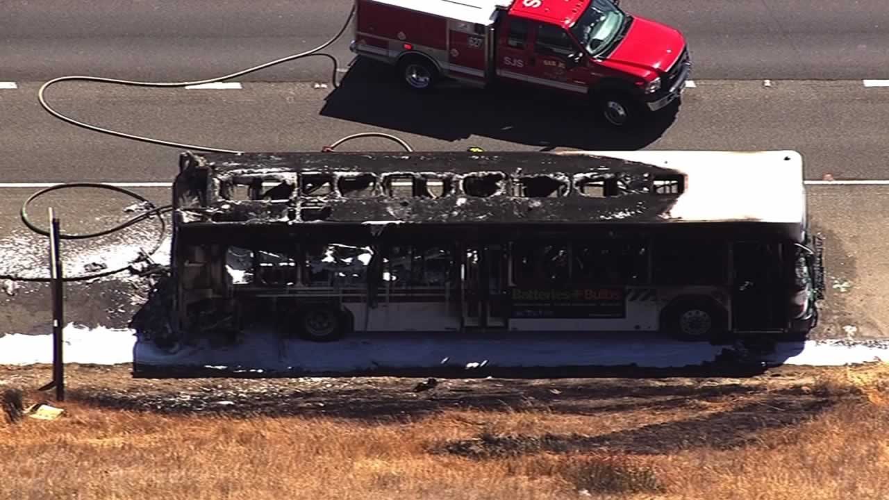 A VTA bus catches fire on Highway 101 in San Jose, sparking a small vegetation fire.