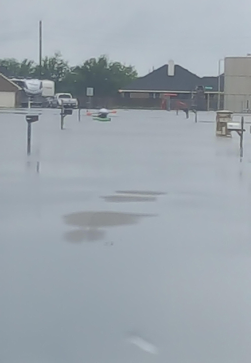 <div class='meta'><div class='origin-logo' data-origin='none'></div><span class='caption-text' data-credit=''>A street in the Needville Rosemeadow Subdivision on Hurricane Harvey. (Amber Atkinson)</span></div>