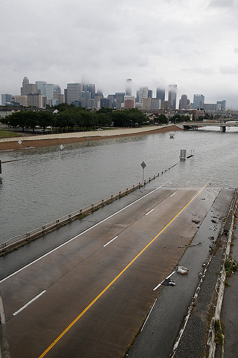 <div class='meta'><div class='origin-logo' data-origin='none'></div><span class='caption-text' data-credit='THOMAS B. SHEA/AFP/Getty Images'>The downtown Houston skyline and flooded highway 288 are seen August 27, 2017 as the city battles with tropical storm Harvey and resulting floods.</span></div>