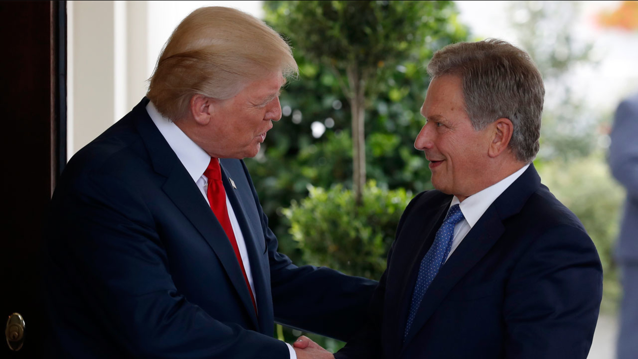 President Donald Trump greets Finnish President Sauli Niinisto as he arrives at the White House in Washington, Monday, Aug. 28, 2017.