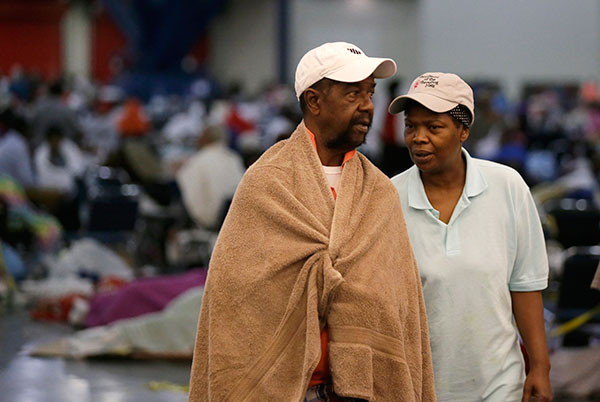 <div class='meta'><div class='origin-logo' data-origin='none'></div><span class='caption-text' data-credit='LM Otero/AP Photo'>Ezekiel Lyons, left, walks with his wife at the George R. Brown Convention Center that has been set up as a shelter on Tuesday, Aug. 29, 2017.</span></div>