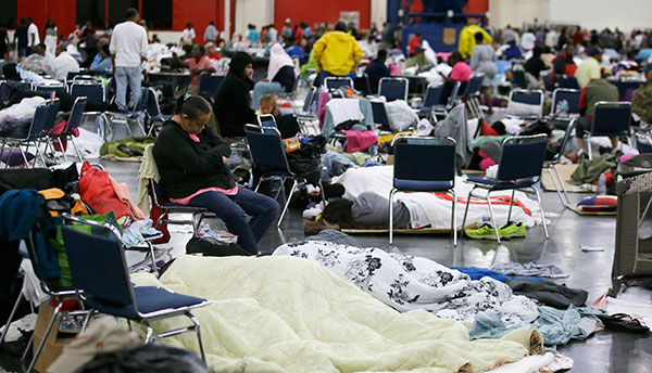 <div class='meta'><div class='origin-logo' data-origin='none'></div><span class='caption-text' data-credit='LM Otero/AP Photo'>People rest at the George R. Brown Convention Center that has been set up as a shelter on Tuesday, Aug. 29, 2017.</span></div>