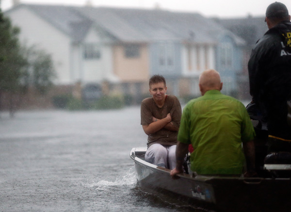 "<div class=""meta image-caption""><div class=""origin-logo origin-image none""><span>none</span></div><span class=""caption-text"">Members of the Louisiana Department of Wildlife and Fisheries and the Houston Fire Department rescue residents stranded from floodwaters. (Gerald Herbert/AP)</span></div>"