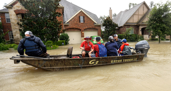 "<div class=""meta image-caption""><div class=""origin-logo origin-image none""><span>none</span></div><span class=""caption-text"">Residents are evacuated as floodwaters from Hurricane Harvey rise Monday, Aug. 28, 2017, in Spring, Texas. (David J. Phillip/AP Photo)</span></div>"