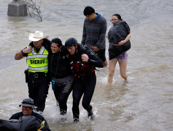 "<div class=""meta image-caption""><div class=""origin-logo origin-image none""><span>none</span></div><span class=""caption-text"">A woman is helped by rescue personnel while being evacuated as floodwaters from Hurricane Harvey rise Monday, Aug. 28, 2017, in Houston. (David J. Phillip/AP Photo)</span></div>"