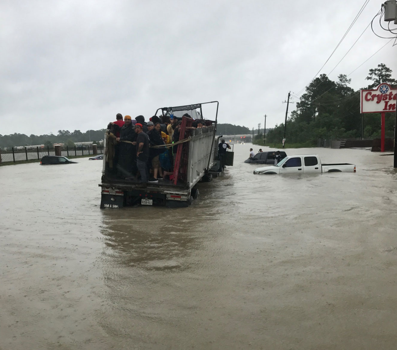 <div class='meta'><div class='origin-logo' data-origin='none'></div><span class='caption-text' data-credit='SheriffEd_HCSO/Twitter'>The Harris County Sheriff posted this photo of residents rescued in a convoy while helping out with rescues on Tidwell Rd in Houston.</span></div>