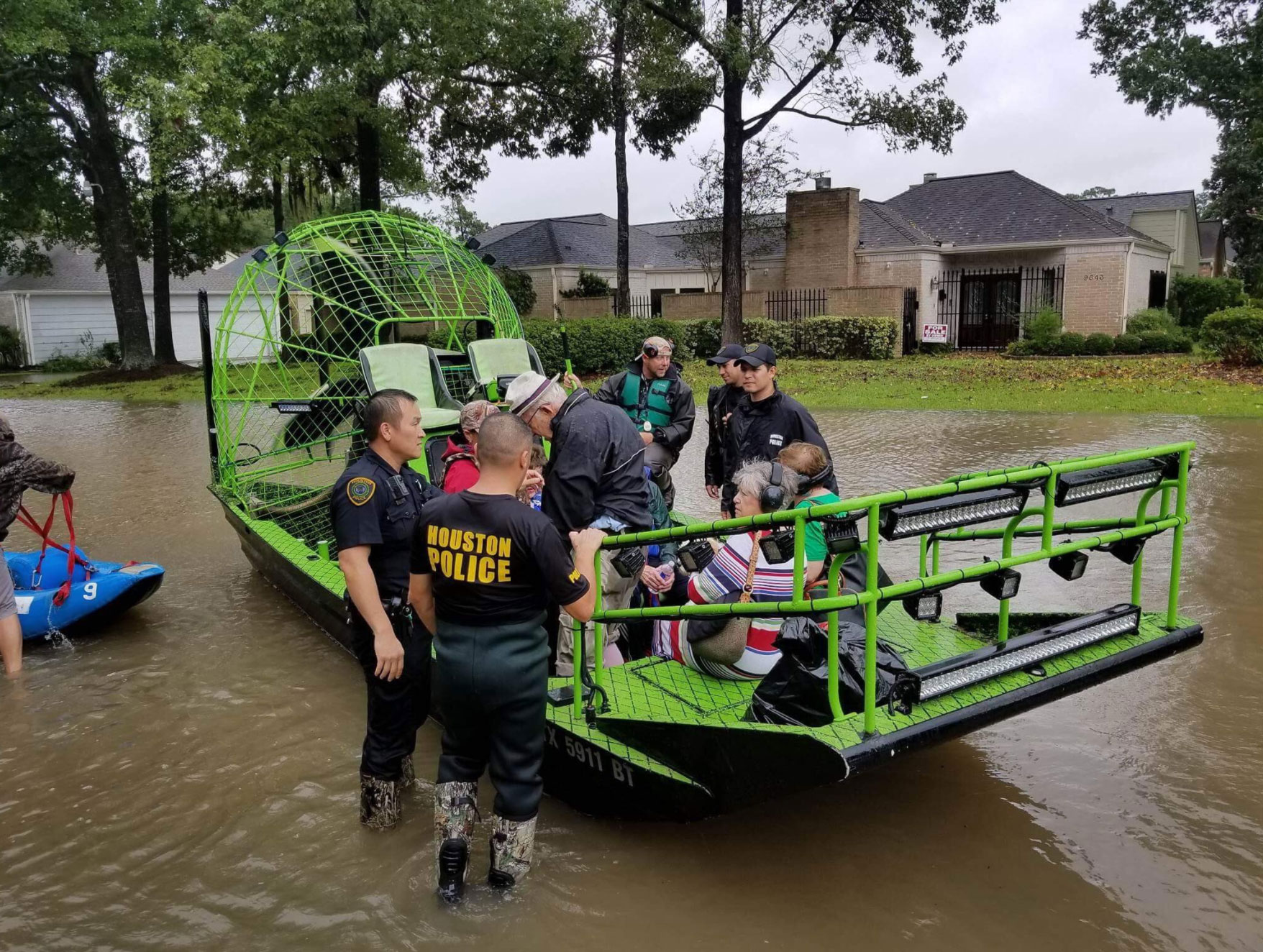 <div class='meta'><div class='origin-logo' data-origin='none'></div><span class='caption-text' data-credit='houstonpolice/Twitter'>The Houston Police rescue a group stranded by the flood.</span></div>