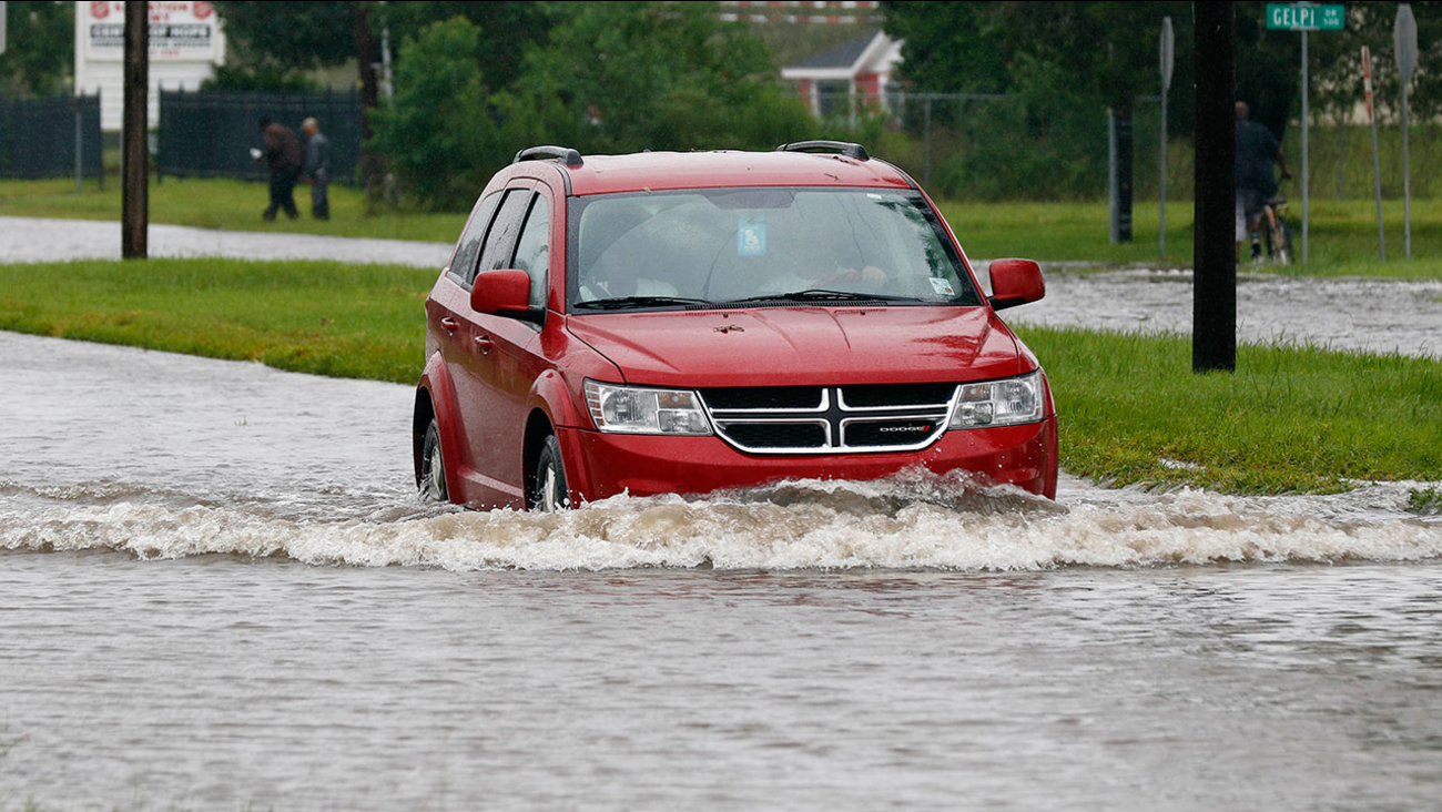 A driver attempts to steer through the remaining floodwaters from Harvey on Legion Street in Lake Charles, La., Tuesday, Aug. 29, 2017.