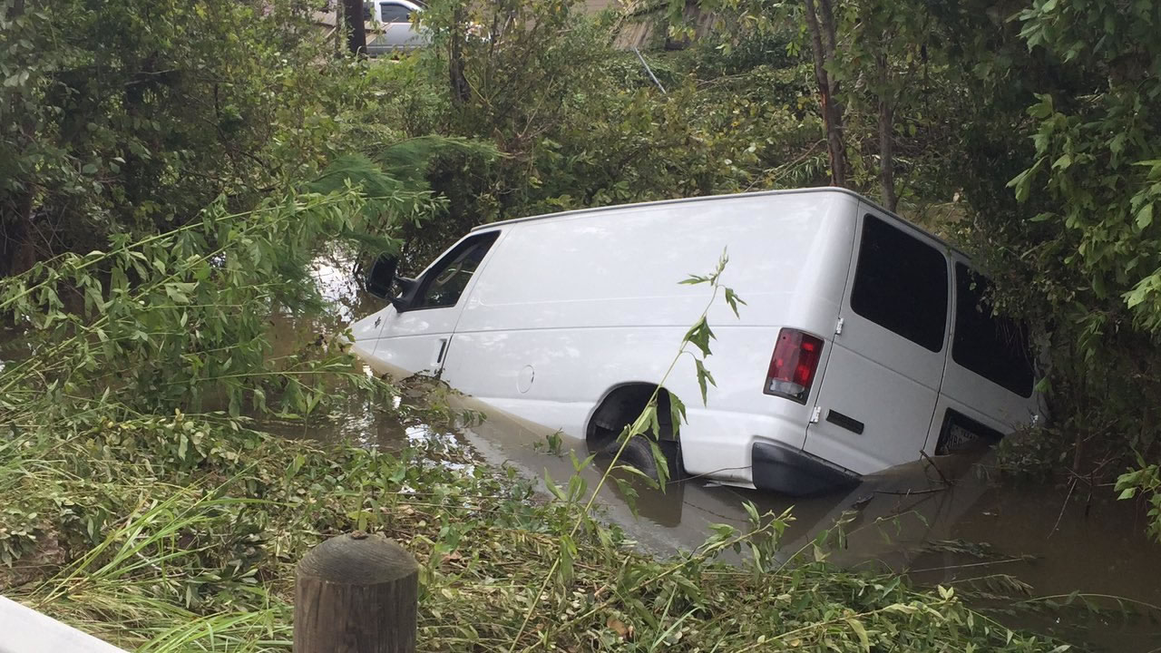 The family's van was located Wednesday morning after getting swept away on Sunday.