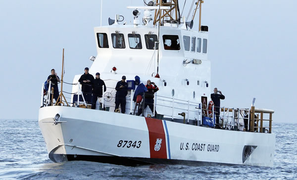 "<div class=""meta image-caption""><div class=""origin-logo origin-image ""><span></span></div><span class=""caption-text"">Crewmen on a U.S. Coast Guard vessel watch the first heat of the first round of the Mavericks Invitational big wave surf contest Friday, Jan. 24, 2014, in Half Moon Bay, Calif. (AP Photo/Eric Risberg) (AP Photo/Eric Risberg)</span></div>"