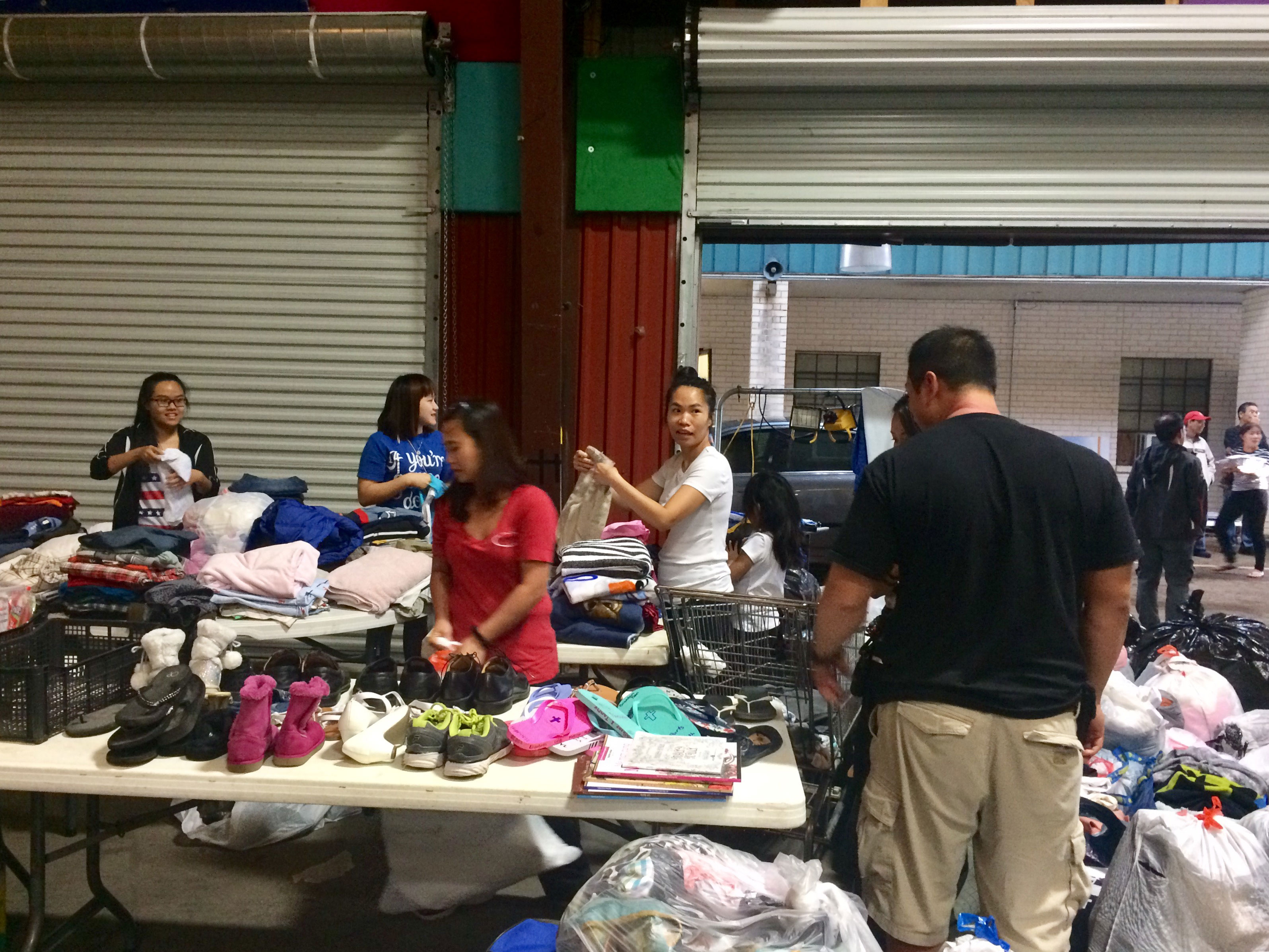<div class='meta'><div class='origin-logo' data-origin='none'></div><span class='caption-text' data-credit='Uyen Do'>Volunteers sort through donations in this viewer-submitted photo.</span></div>