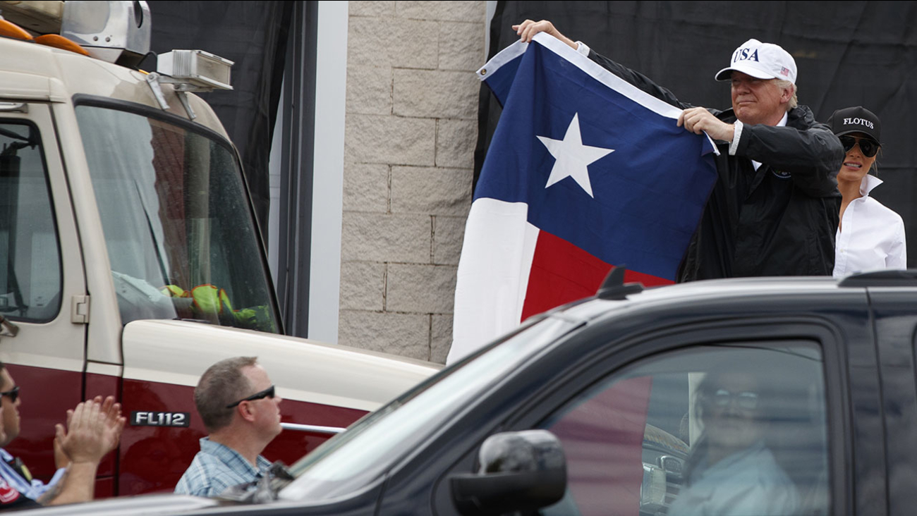 President Donald Trump holds up a Texas flag Tuesday in Corpus Christi, Texas.