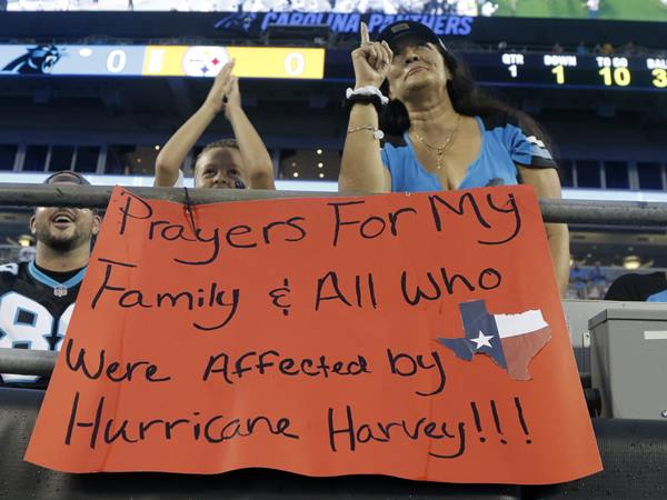 <div class='meta'><div class='origin-logo' data-origin='AP'></div><span class='caption-text' data-credit='Mike McCarn'>A Panthers fan shows her support for those affected by Hurricane Harvey.</span></div>