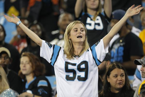 <div class='meta'><div class='origin-logo' data-origin='AP'></div><span class='caption-text' data-credit='Mike McCarn'>This Panthers fan is in midseason form Thursday night.</span></div>