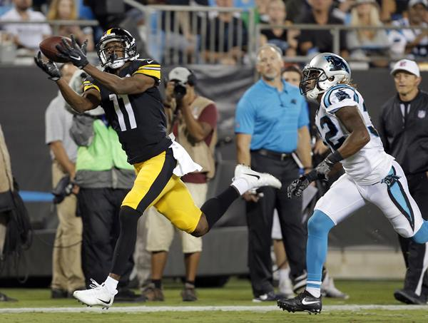 <div class='meta'><div class='origin-logo' data-origin='AP'></div><span class='caption-text' data-credit='Mike McCarn'>Pittsburgh Steelers' Justin Hunter catches a touchdown pass against Carolina Panthers' Cole Luke.</span></div>