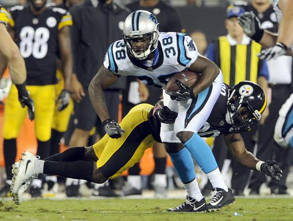 <div class='meta'><div class='origin-logo' data-origin='AP'></div><span class='caption-text' data-credit='Mike McCarn'>Carolina Panthers' Jalen Simmons (38) is hit by Pittsburgh Steelers' Malik Golden.</span></div>
