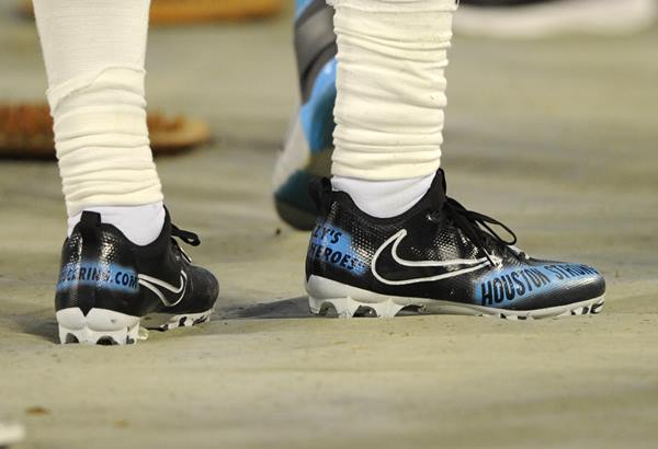 <div class='meta'><div class='origin-logo' data-origin='AP'></div><span class='caption-text' data-credit='Mike McCarn'>Carolina Panthers running back Fozzy Whittaker, a Houston native, shows support on his shoes for his Harvey-ravaged hometown.</span></div>
