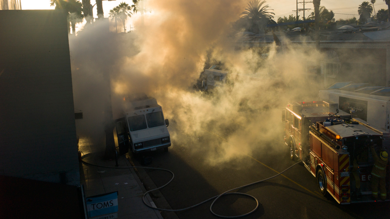 Smoke billows after a fire breaks out on the Miami Nights food truck in Venice on Friday, August 1, 2014.