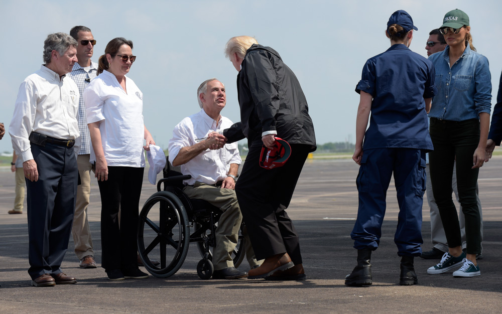 "<div class=""meta image-caption""><div class=""origin-logo origin-image none""><span>none</span></div><span class=""caption-text"">President Donald Trump shakes hands with Texas Gov. Greg Abbott as he and first lady Melania Trump, right, arrive via Air Force One at Ellington Field in Houston. (Susan Walsh/AP Photo)</span></div>"