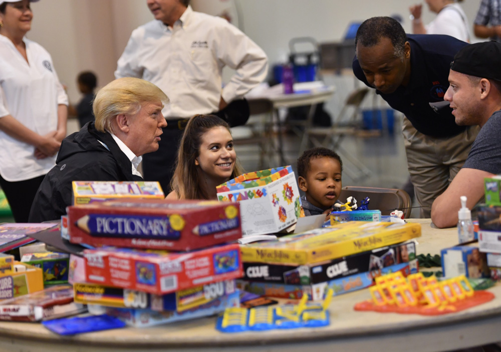 "<div class=""meta image-caption""><div class=""origin-logo origin-image none""><span>none</span></div><span class=""caption-text"">President Donald Trump, with Secretary of Housing and Urban Development Ben Carson (2nd R), visits Hurricane Harvey victims at NRG Center in Houston on September 2, 2017. (NICHOLAS KAMM/AFP/Getty Images)</span></div>"
