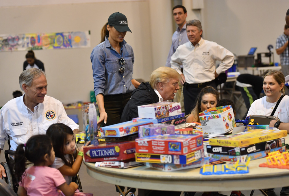 "<div class=""meta image-caption""><div class=""origin-logo origin-image none""><span>none</span></div><span class=""caption-text"">US President Donald Trump, with Texas  Greg Abbott (L) and US First Lady Melania Trump (2nd L) visits Hurricane Harvey victims at NRG Center in Houston on September 2, 2017. (NICHOLAS KAMM/AFP/Getty Images)</span></div>"