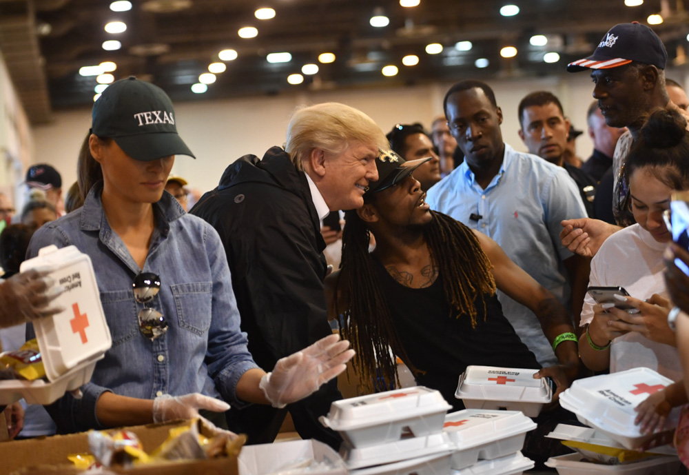 "<div class=""meta image-caption""><div class=""origin-logo origin-image none""><span>none</span></div><span class=""caption-text"">President Donald Trump and First Lady Melania Trump serve food to Hurricane Harvey victims at NRG Center in Houston on September 2, 2017. (NICHOLAS KAMM/AFP/Getty Images)</span></div>"