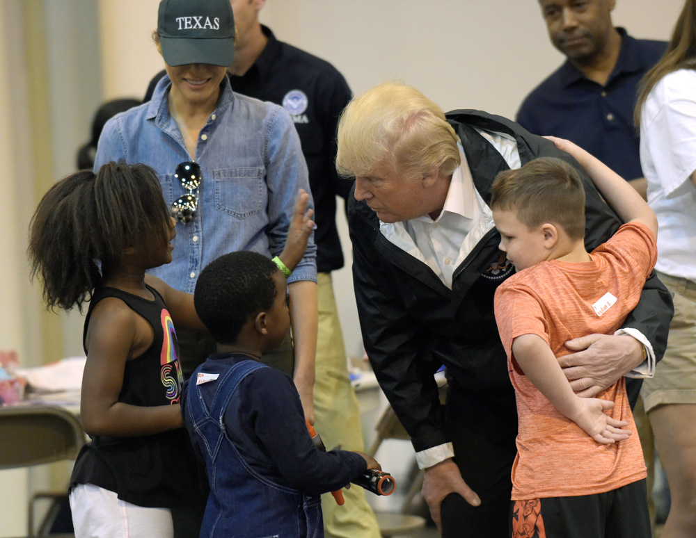 "<div class=""meta image-caption""><div class=""origin-logo origin-image none""><span>none</span></div><span class=""caption-text"">President Donald Trump and Melania Trump meet people impacted by Hurricane Harvey during a visit to the NRG Center in Houston, Saturday, Sept. 2, 2017. (Susan Walsh/AP Photo)</span></div>"