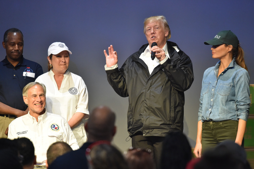 "<div class=""meta image-caption""><div class=""origin-logo origin-image none""><span>none</span></div><span class=""caption-text"">President Donald Trump speaks to volunteers at the First Church of Pearland on September 2, 2017, while visiting areas affected by Hurricane Harvey. (NICHOLAS KAMM/AFP/Getty Images)</span></div>"