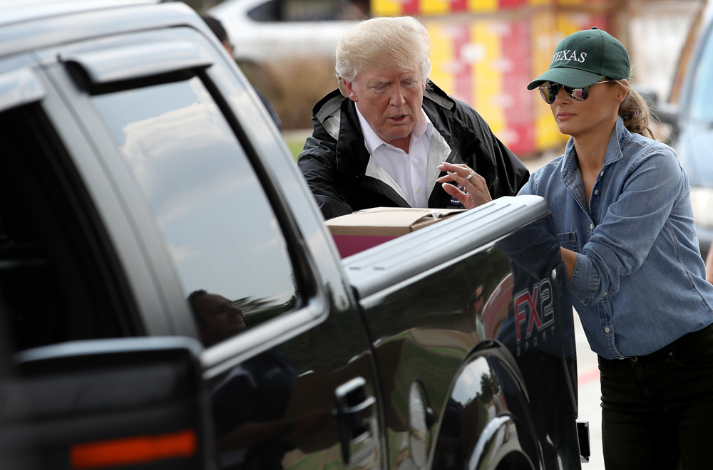 "<div class=""meta image-caption""><div class=""origin-logo origin-image none""><span>none</span></div><span class=""caption-text"">President Donald Trump and first lady Melania Trump hand out emergency supplies to residents impacted by Hurricane Harvey while visiting the First Church of Pearland. (Win McNamee/Getty Images)</span></div>"