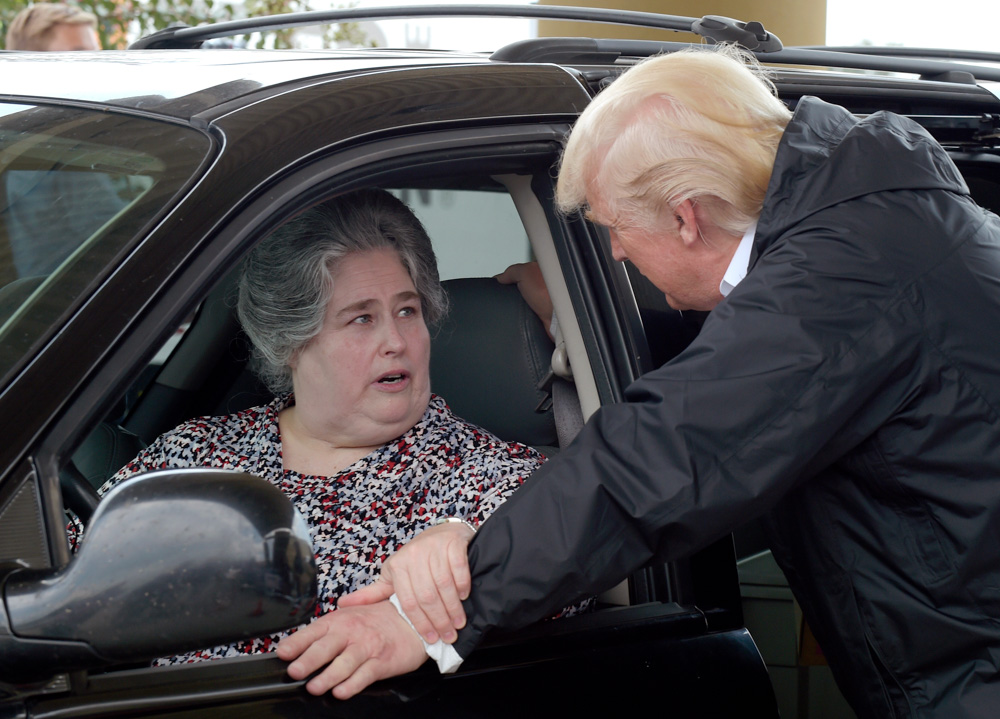 "<div class=""meta image-caption""><div class=""origin-logo origin-image none""><span>none</span></div><span class=""caption-text"">Trump told drivers outside the First Church in Pearland, ""Take care of yourself."" Drivers, in turn, thanked Trump and said they are praying for him. (Susan Walsh/AP Photo)</span></div>"