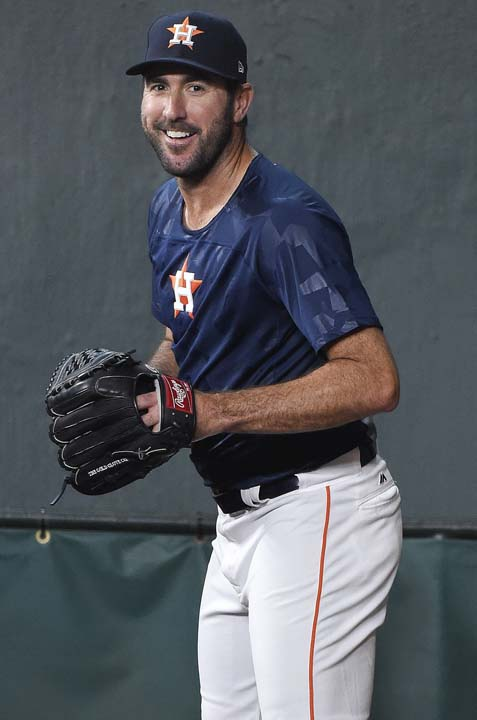 <div class='meta'><div class='origin-logo' data-origin='AP'></div><span class='caption-text' data-credit='Eric Christian Smith'>Houston Astros pitcher Justin Verlander smiles in the bullpen before the second game of the team's baseball doubleheader against the New York Mets.</span></div>
