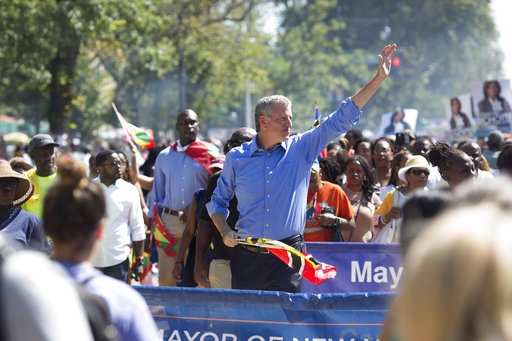 <div class='meta'><div class='origin-logo' data-origin='AP'></div><span class='caption-text' data-credit='Kevin Hagen'>New York Mayor Bill de Blasio walks in the West Indian Day Parade on Monday, Sept. 4, 2017, in the Brooklyn borough of New York.</span></div>